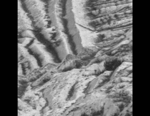In this zoomed-in image of Europa's surface, captured by NASA's Galileo mission, the thin, bright layer, visible atop a cliff in the center shows the kind of areas churned by impact gardening. (NASA/JPL-Caltech)