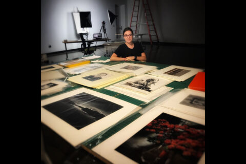 Austin Peay State University art student Katie Boyer with some of the photos she's working with this summer. (APSU)