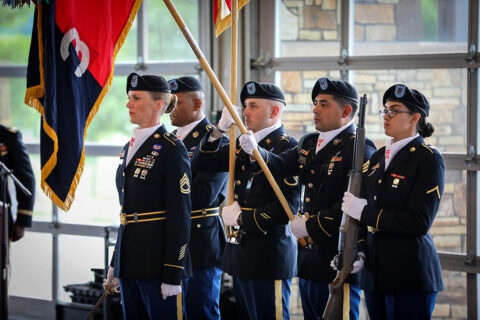 Sgt. 1st Class Christina Kent leads the Colour Guard in a salute during the singing of the National Anthem during a memorial dinner at the Wilma Rudolph Event Center in Clarksville, Tennessee, during a week's long reunion on Fort Campbell June 24th, 2021. (Staff Sgt. Michael Eaddy)