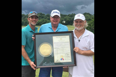 Bobby Keel, right, accepts a framed Joint House Resolution from Rep. Curtis Johnson. At left is Keel's son, Robby Murphy. (Marlin Huddleston)