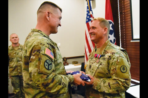 Brig. Gen. Jimmie Cole, Tennessee's Land Component Commander, presents Command Sgt. Maj. Michael Gentry with an American flag at Gentry's retirement ceremony, July 8th, at Smyrna's Event Center. Gentry served for more than 36 years and was the State Command Sergeant Major from October 2015 until he retired this year.