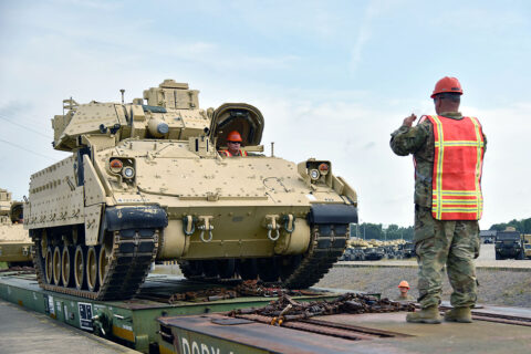 Soldiers assigned to the 278th Armored Cavalry Regiment load a Bradley Fighting Vehicle onto a train in preparation for movement to Fort Hood, Texas, June 21. Approximately 1,000 vehicles, tanks and pieces of equipment are being loaded onto trains in preparation for XCTC, a three-week training exercise that will be taking place in Fort Hood over the summer. (Sgt. 1st Class Timothy Cordeiro)