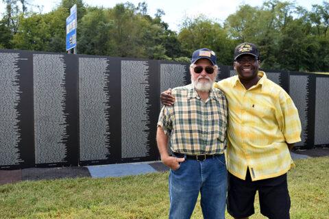 Veterans by the Vietnam Memorial Wall.