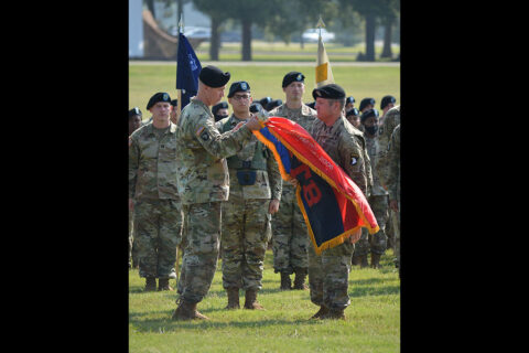 Lt. Col. Robert Gray (center left), commander, and Command Sgt. Maj. Jason Enochs (center right), 101st Special Troops Battalion, 101st Division Sustainment Brigade (DSB), uncase the unit's colors marking the end of their deployment in support of Operation Spartan Shield during uncasing ceremony at Fort Campbell August 3rd, 2021. (U.S. Army photo by Sgt. 1st Class Carlos Davis, 101st Division Sustainment Brigade Public Affairs).