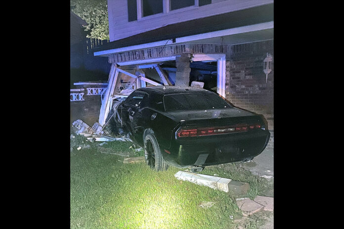 One of the vehicles involved in the shooting ran into the garage door of an unoccupied house. (CPD Officer Dill)