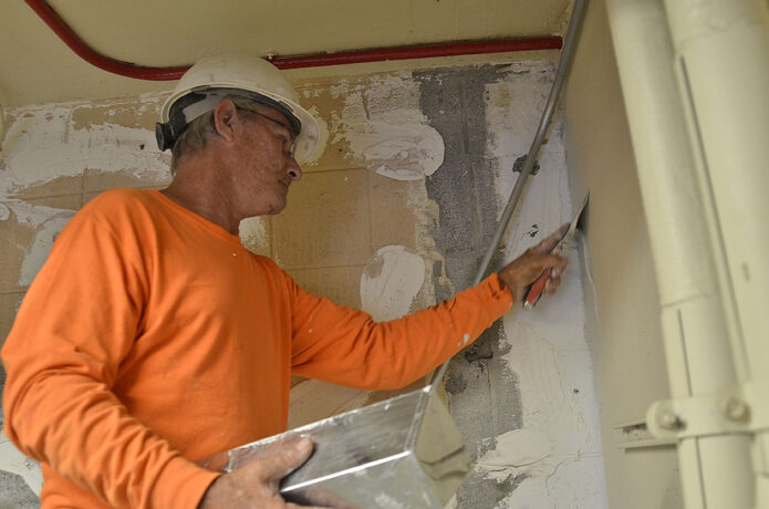 Ken Bamford, carpenter, INTEC Group, patches drywall at building 4038 Sept. 9 as part of ongoing barracks renovations in 1st Brigade Combat Team's footprint. Large-scale construction efforts are underway in Bastogne's footprint as the Fort Campbell Directorate of Public Works, or DPW, aims to improve housing conditions, quality of life and more for Soldiers. Active projects include major barracks renovations and ventilation improvements, repaving efforts on Tennessee and Indiana avenues and a variety of smaller projects. (Ethan Steinquest, Fort Campbell Public Affairs Office)