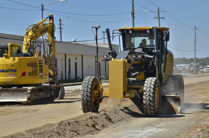 Brad Alexander, vice president, Double A Services, grades a portion of Tennessee Avenue Sept. 7. The work is underway at Tennessee and Indiana avenues and will include repaving streets and parking lots, improving drainage systems and installing new sidewalks. This project is part of a large-scale renovation effort within the 1st Brigade Combat Team's footprint that also includes barracks renovations and ventilation improvements. (Ethan Steinquest, Fort Campbell Public Affairs Office)