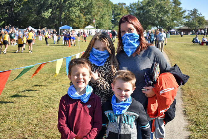 A visiting family masks up at the TSSAA Middle Cross County State Finals held in Clarksville in October 2020. (Visit Clarksville)