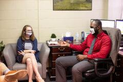 Edwards and Mejeun discuss her graduate teaching assistantship. (APSU)