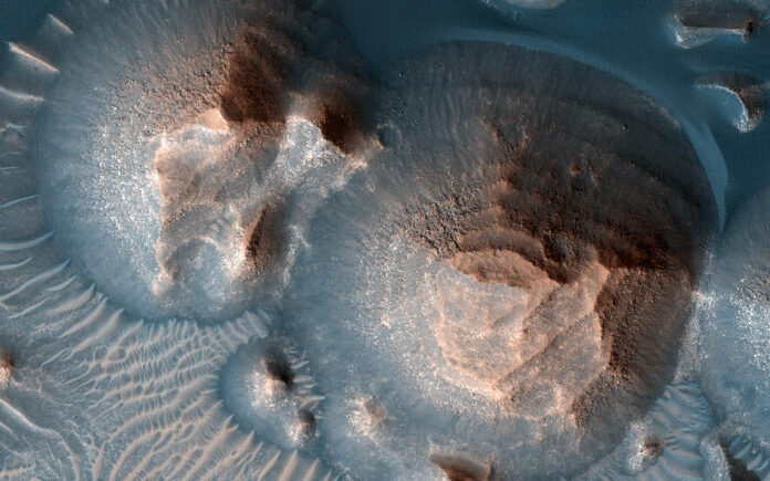 This image shows several craters in Arabia Terra that are filled with layered rock, often exposed in rounded mounds. The image was taken by a camera, the High Resolution Imaging Experiment, on NASA's Mars Reconnaissance Orbiter. (NASA/JPL-Caltech/University of Arizona)