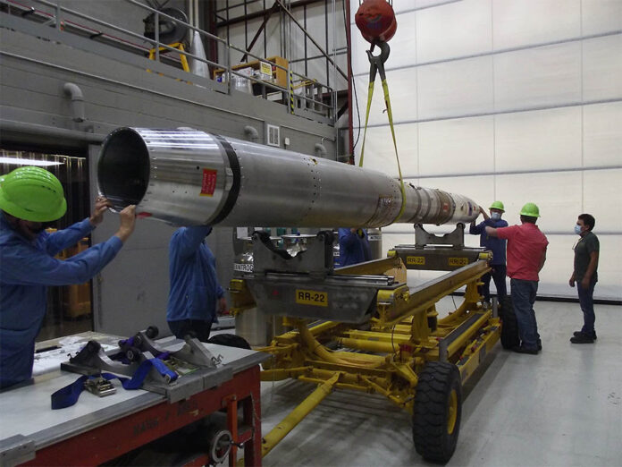 The EVE payload is loaded onto a cart for transport at the White Sands Missile Range. (NASA)