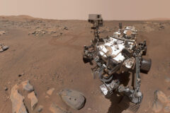 """Using its WATSON camera, NASA's Perseverance Mars rover took this selfie over a rock nicknamed """"Rochette,"""" on Sept.10, 2021, the 198th Martian day, or sol, of the mission. Two holes can be seen where the rover used its robotic arm to drill rock core samples. (NASA/JPL-Caltech/MSSS)"""