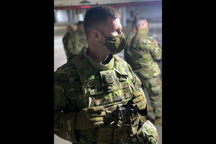 Master Sgt. Seth Carter, of the Kentucky Army National Guard's 1123rd Engineer Company (Sapper), watches Soldiers participate in a training exercise with U.S. Capitol Police in Washington, D.C., Feb. 18, 2021. The National Guard has been requested to continue supporting federal law enforcement agencies with security, communications, medical evacuation, logistics, and safety support to state, district and federal agencies through mid-March. (U.S. Army National Guard, Capt. Cassandra Mullins)