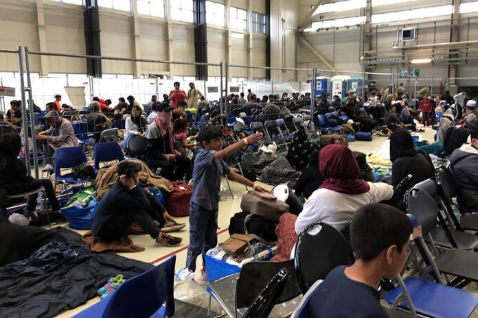 A departure lounge is set up in a C-5 hangar at Ramstein Air Base, Germany for Afghan refugees on their way to America, September 10th, 2021. (Jim Garamone, DOD)