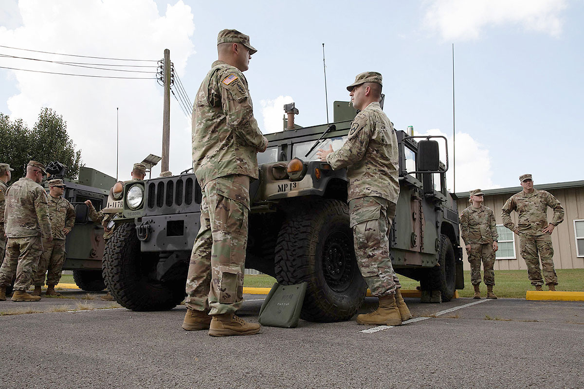 Soldiers with the Tennessee Army National Guard prepare to receive instruction on vehicle preventive maintenance, care and services during the First Line Leadership Course pilot in Smyrna on Sept. 14. The course provided the Soldiers with refreshers on soldiering skills and supplied them with administrative information that they could provide to their units. (Pfc. Olivia Gum)