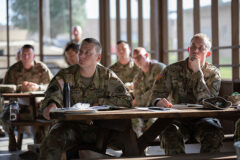 Soldiers with the Tennessee Army National Guard listen to a block of instruction during the First Line Leadership Course pilot in Smyrna on Sept. 14. The Soldiers were instructed on troop leading procedures, conducting troop inspections and given a brief description on the next day's field exercise. (Pfc. Olivia Gum)