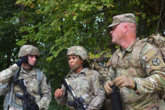 Sgt. Jonathan Roberts (left), and Staff Sgt. Tamecca Johnson (center), students of the First Line Leadership Course pilot, discuss tactical squad movements with instructor Sgt. First Class Brandon Kolesar (right), in Smyrna on Sept. 15. The course participants built a terrain model, conducted a tactical squad movement and practiced medical evacuation procedures. (Sgt. Finis L. Dailey, III)