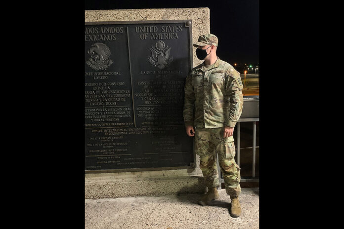 Staff Sgt. Christopher Hurley, a resident of Soddy Daisy, Tennessee, and assigned to the 913th Engineer Company of the Tennessee National Guard, poses for a photo at the Laredo International Bridge in Texas. Hurley saved the life of a pedestrian on Sept. 20 by performing CPR while supporting the Department of Defense's Southwest Border mission.