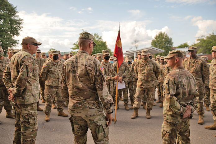Maj. Gen. Jeff Holmes, Tennessee's Adjutant General, and Command Chief Master Sgt. Kenneth Simmons, Tennessee's Senior Enlisted Leader, meet with Soldiers from the 1176th Transportation Company, September 1, at Smyrna's Volunteer Training Site, prior to the unit's mobilization to Louisiana. (Staff Sgt. Timothy Cordeiro, Tennessee National Guard Public Affairs)