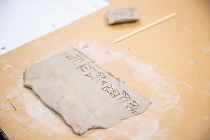Cuneiform script on clay. (APSU)