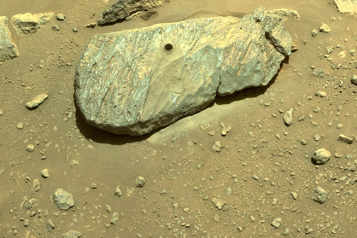 The drill hole from Perseverance's second sample-collection attempt can be seen, in this composite of two images taken on September 1st, 2021, by one of the Perseverance rover's navigation cameras. (NASA/JPL-Caltech)